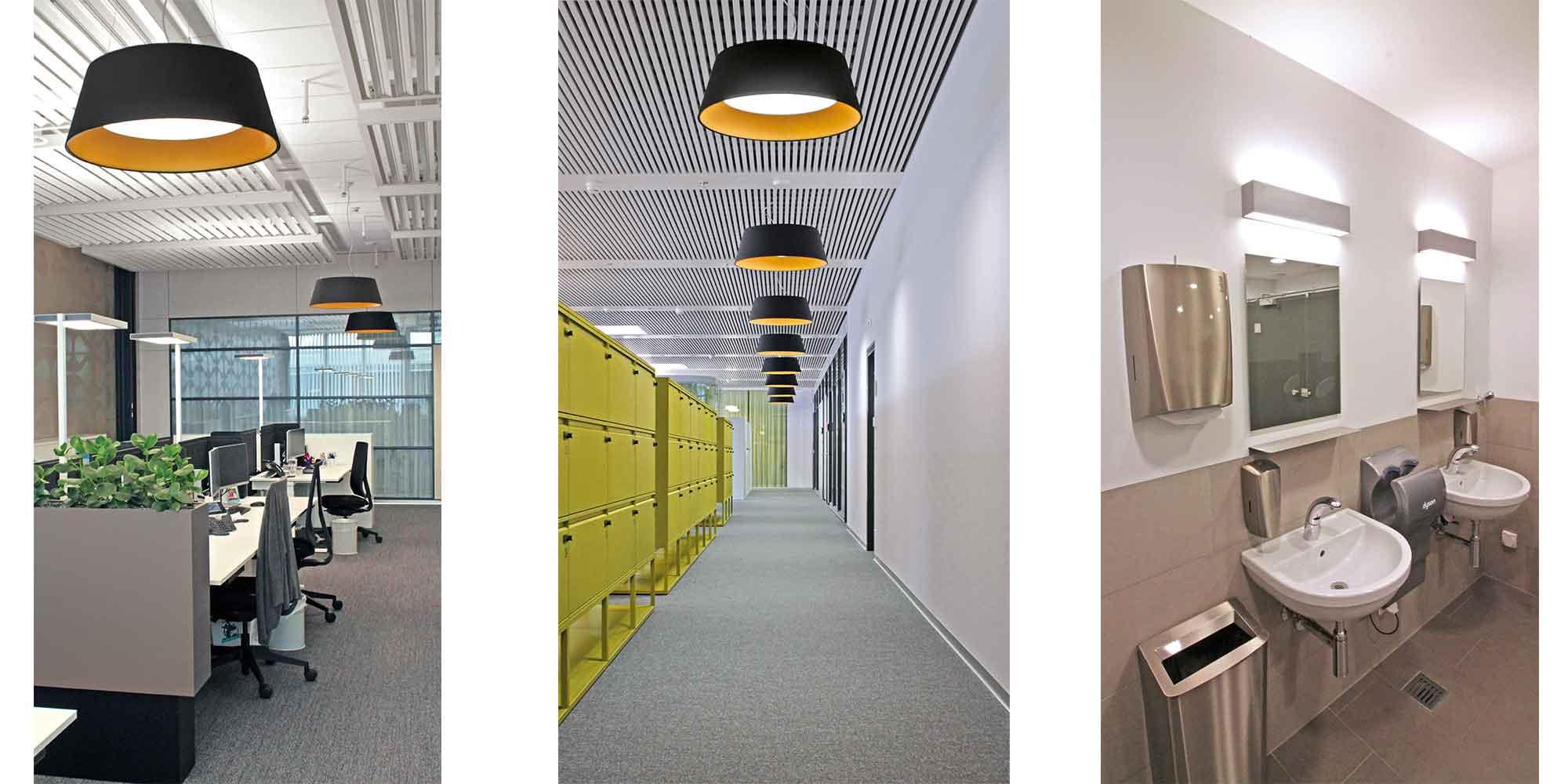 Der Flur eines Grossraumbüros in Schönbühl mit den eleganten Beam me up von Lightnet ausgestattet, ausserdem werden die Toiletten mit den Matric Wandleuchten auch von Lightnet ausgestattet